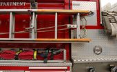 picture of fire truck  - Image of a ladder secured to a fire truck - JPG