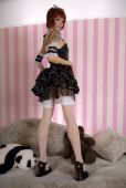 image of lolita  - Attractive girl dressed like Gothic Lolita in funny interior - JPG
