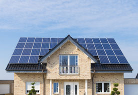 picture of roof-light  - new house with solar panels on its roof - JPG