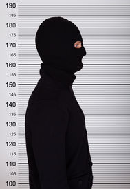 picture of lineup  - Burglar Wearing Balaclava Standing Against Police Lineup - JPG