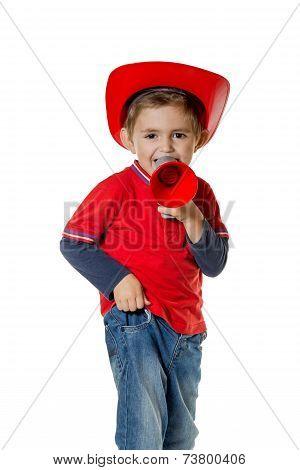 Cute Young Boy In A Fireman Helmet