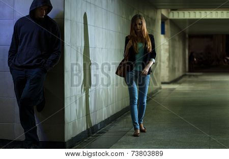 Lonely Woman Walking At Night