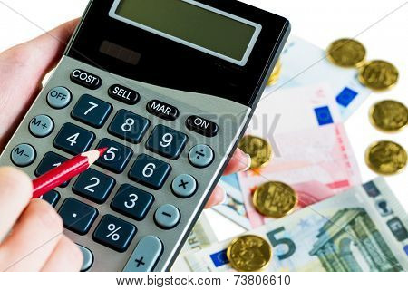 hand with calculator and bills. symbol photo for sales, profits, taxes and costing