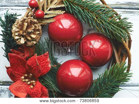 Composition of three red bubbles in Christmas wreath