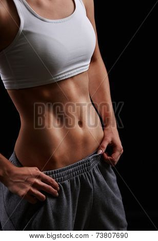 Body of fit female in sportswear in isolation