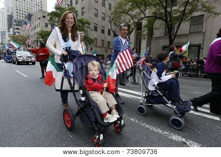 Little parade goer in stroller with US flag