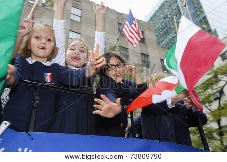 Kids with flag on float