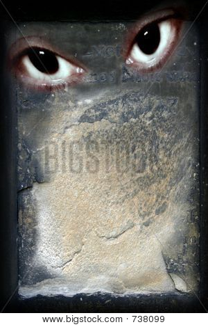 Stone Background Notice Board With Sinister Eyes Looking Outward And Space For Your Text