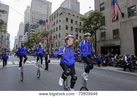 Gym dandies work unicycles