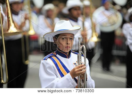 Marching band member with silver horn