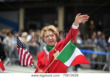 Parade participant with US & Italian flags