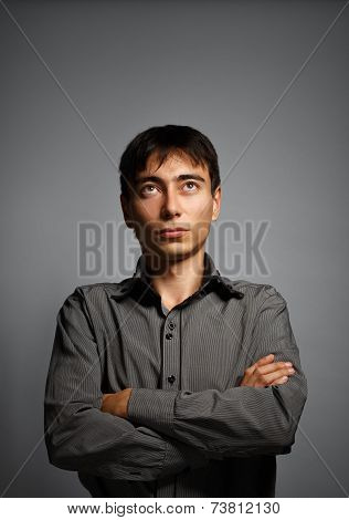 Man In Thoughtful Pose On Grey Background