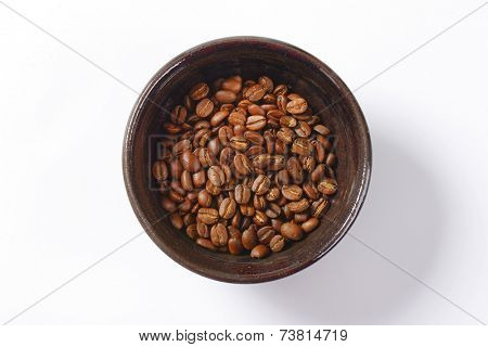 overhead view of bowl with roasted arabica coffee