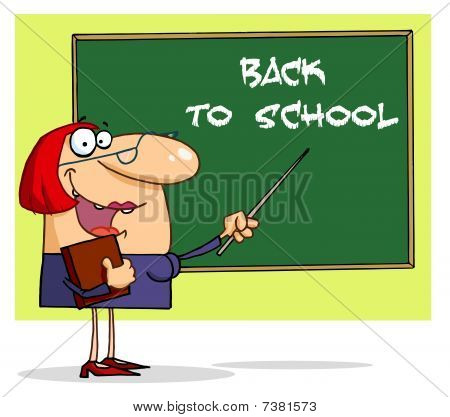 Female Teacher Pointing To A Back To School Chalkboard