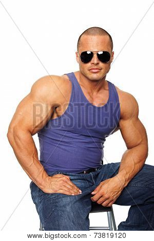 Muscular man on chair