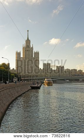Moscow City Center Highrise Tower On The Sunrise And Yacht Sailing In The River
