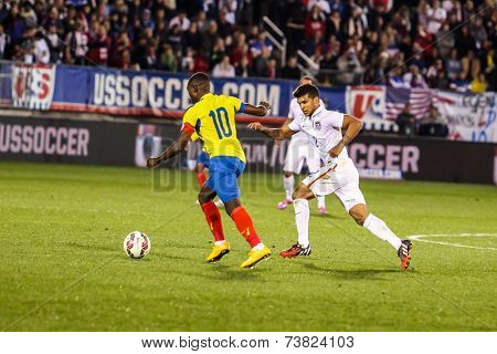 HARTFORD - OCTOBER 10:  DeAndre Yedlin #2 with ecuadorian player #10 on US  Friendly match between US Men`s National Team vs Ecuador,  on October 10, 2014, in Rentschler Field stadium, Hartford, USA.