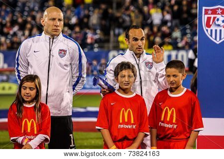 HARTFORD - OCTOBER 10: Brad Guzan and Landon Donovan with kids on stadium before socce match between US Men`s National Team vs Ecuador, on October 10, 2014, in Rentschler Field stadium, Hartford, USA.