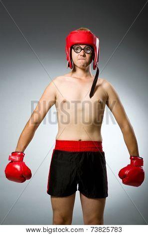 Funny nerd boxer in sport concept