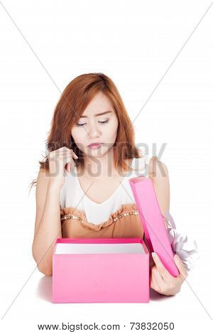 Asian Girl Fed Up Look At A Gift Box