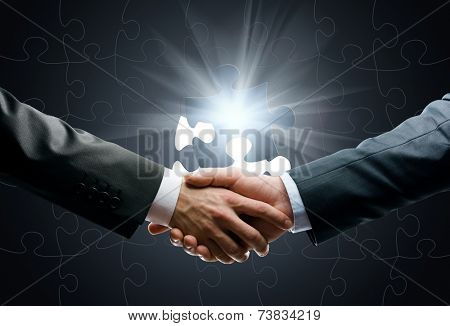 Close up of handshake of business people against world connection background. Concept of trustworthy relations and business cooperation