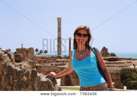 Smiling Woman Against Ruins Of Carthage In Tunisia