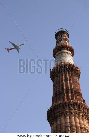 Qutb Minar Minaret And A Plane, Delhi, India