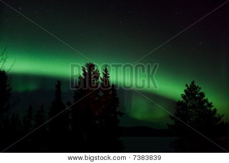 Aurora Borealis (northern Lights) Display Over Frozen Lake Laber