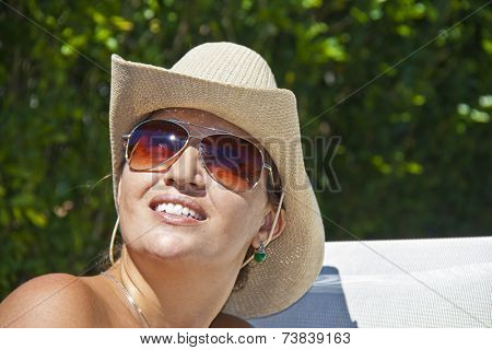 Brazilian woman in a sizzling hot day in the summer time.
