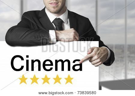 Businessman Pointing On Sign Cinema