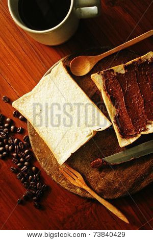 Still life Breakfast set, bread toast chocolate spread with hot coffee and coffee beans