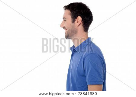 Side View Posing Of Smiling Guy