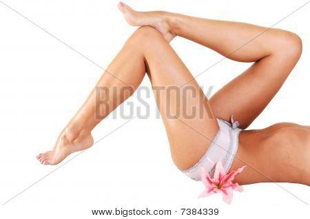 Woman Lying On Floor Shooing Her Legs.
