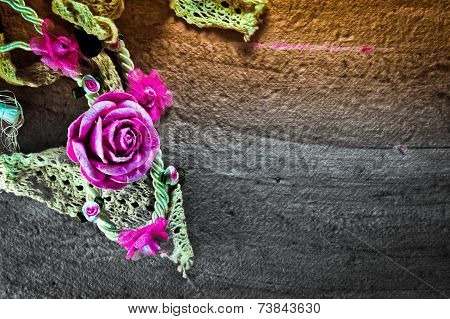 Vintage Of Artificial Flowers Rose On The Old Paper Stripes.