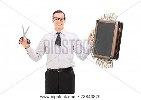 Young businessman with cut tie holding bag full of money isolated on white background