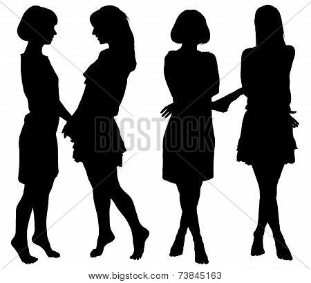 silhouette of two young slender women