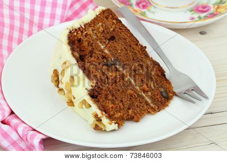 Carrot cake with walnuts and marzipan icing