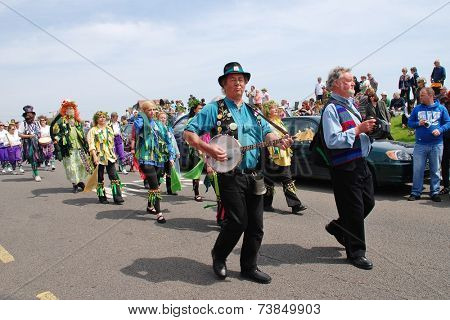 HASTINGS, ENGLAND - MAY 5, 2014: Musicians perform during the parade on the West Hill at the annual Jack In The Green festival. The event marks the May Day public holiday.