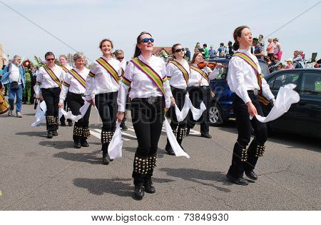 HASTINGS, ENGLAND - MAY 5, 2014: Morris dancers perform during the parade on the West Hill at the annual Jack In The Green festival. The traditional event marks the May Day public holiday in Britain.
