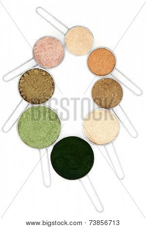 Body building and health food supplement powders in metal scoops over white background.