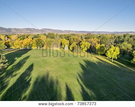 aerial view of park in fall colors under morning light with deep long shadows, Fort Collins, Colorado,