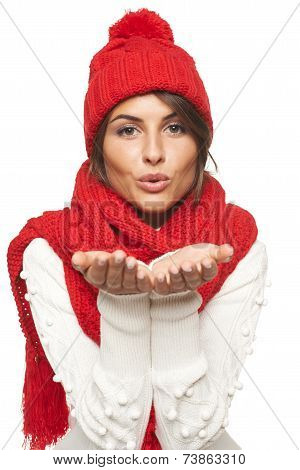 Winter woman blowing a kiss