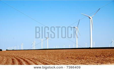 Plowed Field And Wind Turbines