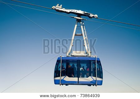 mountain lift (funicular) at the top, clean sky background