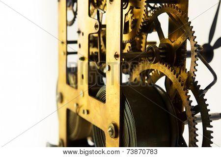Clockwork. Old brass gears and springs of old clock mechanism