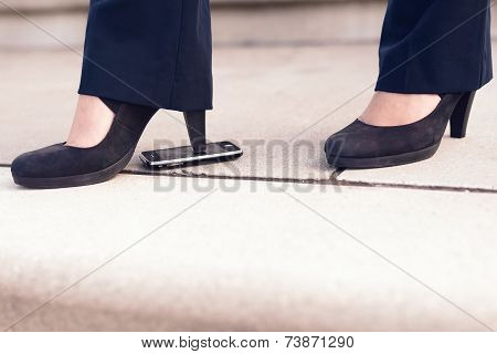 Woman In Black Heel Shoes Step On Phone