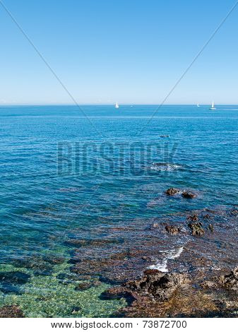 Small Boats In Turquoise Waters