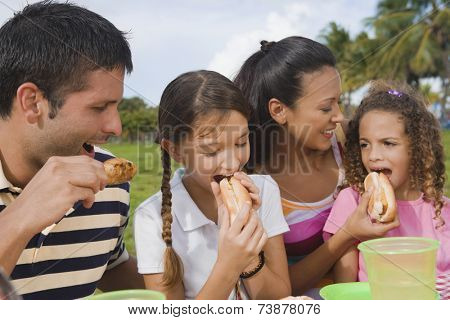 Hispanic family eating outdoors