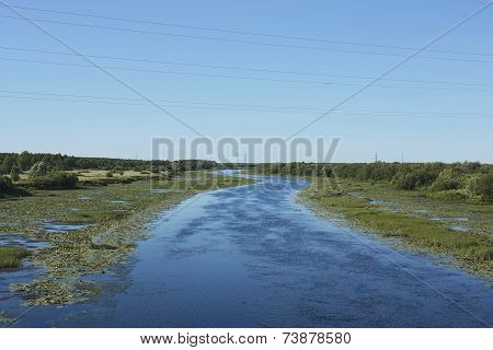 River With  Curved Riverbed And Water Lilies