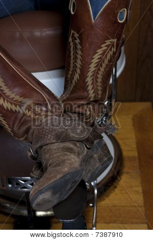 Legs With Cowboy Boots In A Shoeshine Chair